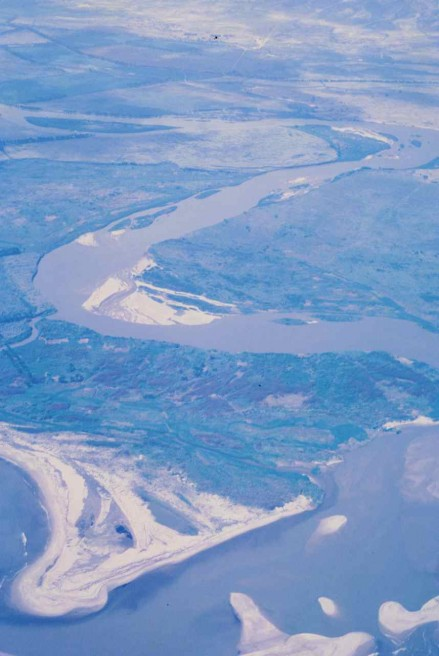 Figure 102 - The Catumbela River meanders and its mouth into the Atlantic Ocean (Angola).