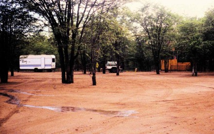 Figure 148 - Large mining group entrance to their camping site and chief geologist's caravan (Caama region, Angola)