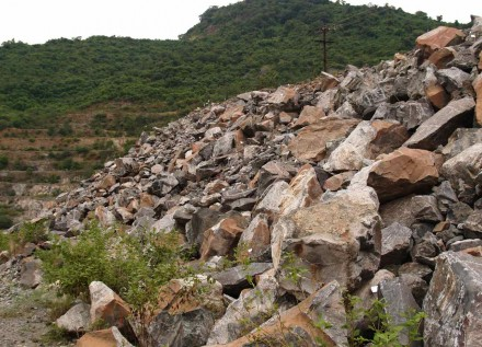 Figure 161 - Chrome mine waste dump sampled for platinum (white tags on little metal rods) (Boula, India).