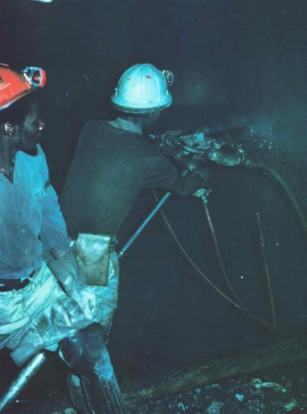 Figure 186- Underground drilling team. B - Raise borer hole (East Driefontein Gold Mine, Carletonville South Africa).